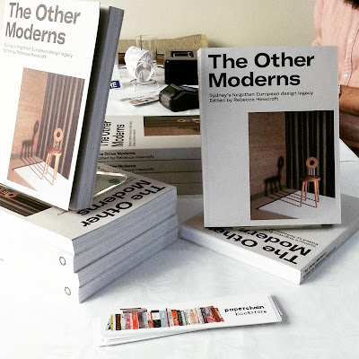 Display of copies of the book The Other Moderns on a table.