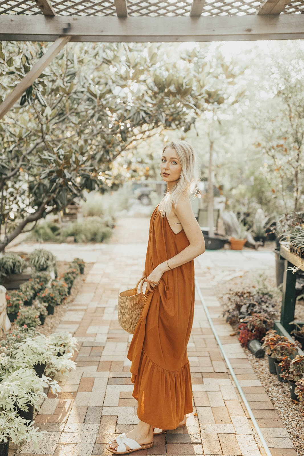 loose maxi dress with a straw tote