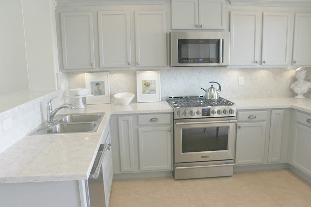 Serene Nordic French Kitchen with Grey Cabinets, Soprano quartz countertop and backsplash