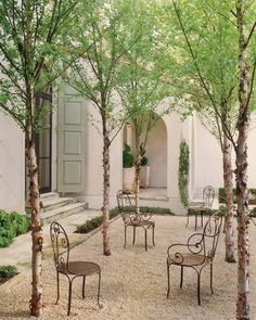 French style courtyard with gravel and chairs by Eleanor Cummings