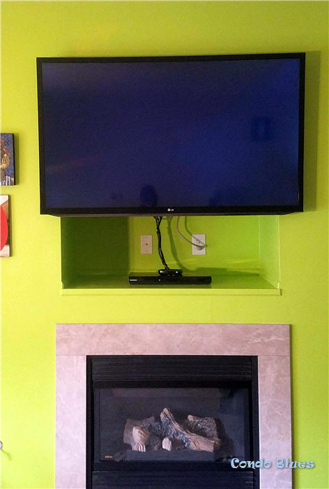 how to hang a flat panel tv over a fireplace