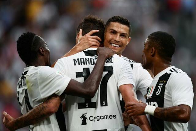 Cristiano Ronaldo Celebrates with Juventus teammates