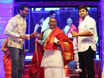 Iiaiyaraaja-felicitated-by-mohan-babus-son