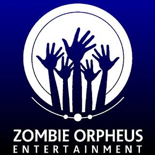 The ZOE logo: a white circle with five hands rising up from the bottom in silhouette, as if they were the hands of zombies erupting up out of the ground. A short arc, about a quarter the circumference of the white circle, concentric with the white circle, runs along the bottom edge of the circle, bisecting three dots. This logo, which is white on a background of dark blue fading to black in gradient, is the inverse of the normal colours: a black logo on a white background.