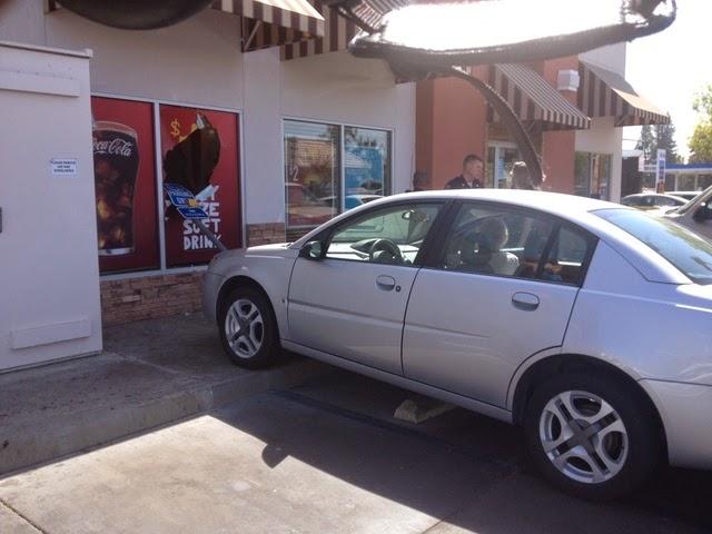 car hits mcdonald's sign breaks window bakersfield kern county crash stockdale highway