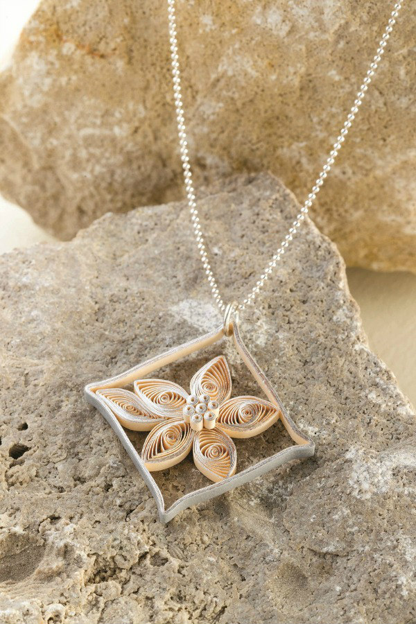 silver quilled paper diamond flower pendant on a silver necklace chain