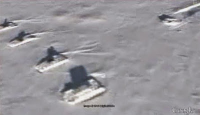 Close up image of the UFO crash site and the Tanks guarding it in Antarctica.