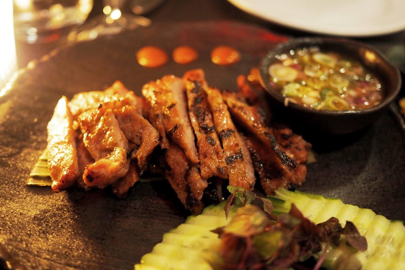 slices of barbecued pork served with cucumber