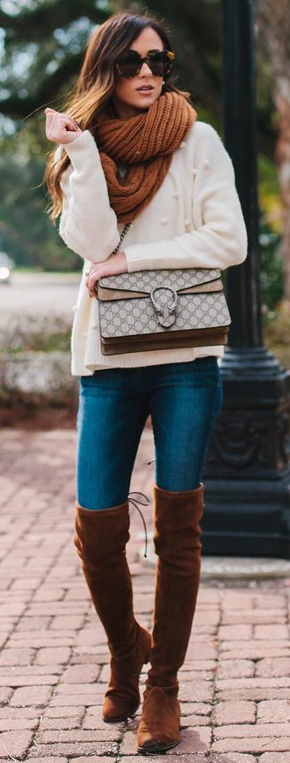 cozy winter outfit idea : knit scarf + white sweater + skinny jeans + brown over knee boots + bag