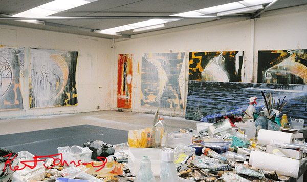 Studio of John Firth-Smith; Brushes, Paint tubes and artworks against the wall