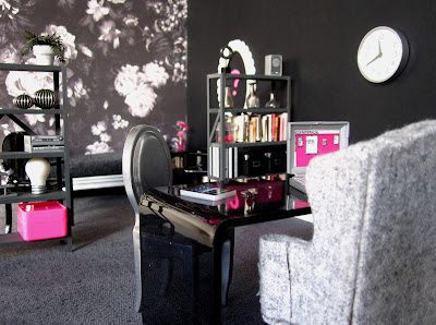 One-twelfth scale modern miniature office scene in shades of black, grey and hot pink.
