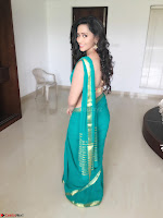 Sanjana Singh Looks Super cute in Green Saree Sleeveless Choli 8.JPG