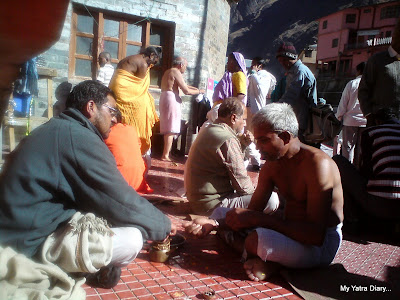 Person performing puja in Badrinath