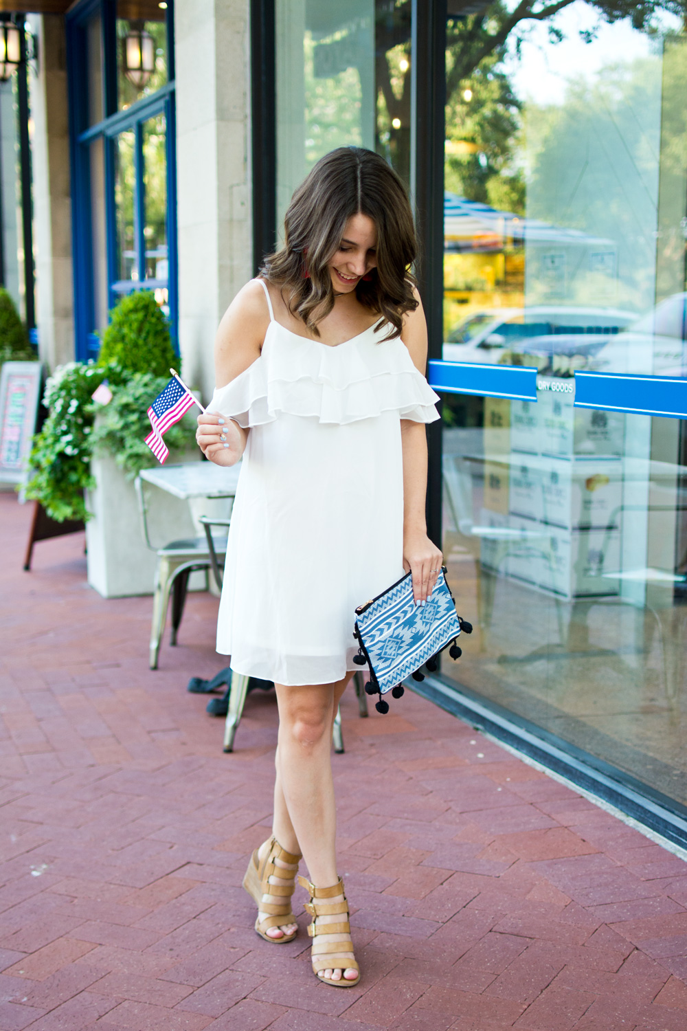 White off the shoulder sundress and blue pom pom clutch styled for summer