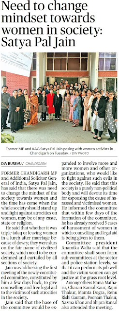 Former MP and Additional Solicitor General Satya Pal Jain posing with women activists in Chandigarh on Tuesday.