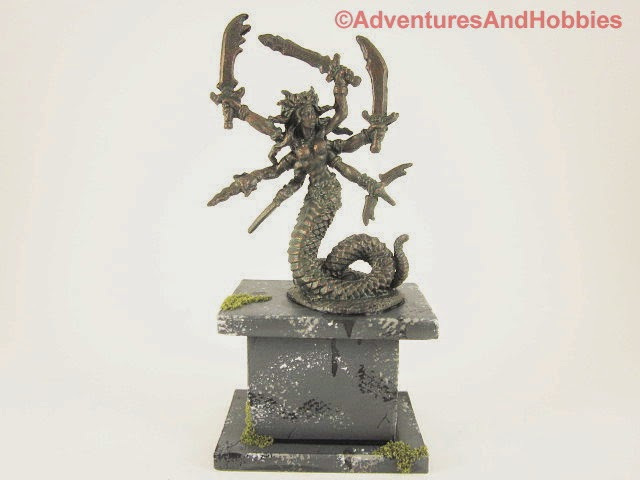 Miniature snake goddess of war statue in 25-28mm scale - front view.
