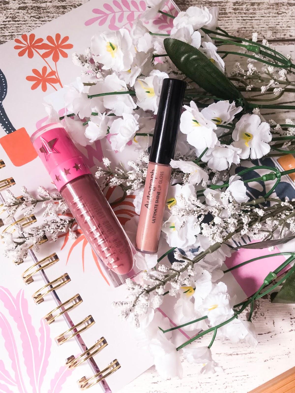 liquid lipstick and lip gloss flatlay