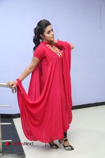 Actress Poorna Latest Stills in Red Dress at Rakshasi First Look Launch  0314.JPG