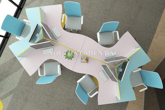 Một chiếc bàn làm việc văn phòng có kết cấu độc đáo, tích hợp không gian làm việc của các cá nhân vừa tiết kiệm diện tích không gian vừa đảm bảo sự linh hoạt