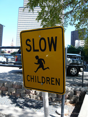 "A street sign saying ""slow children"""