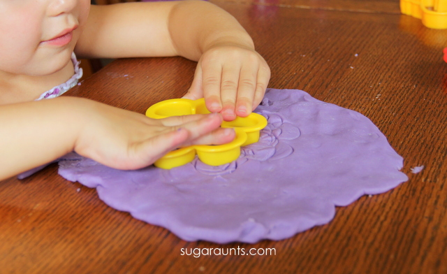 Child playing with DIY play dough made from purple crayons