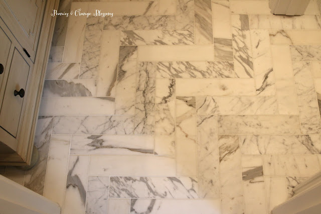 calacatta marble herringbone tile floor