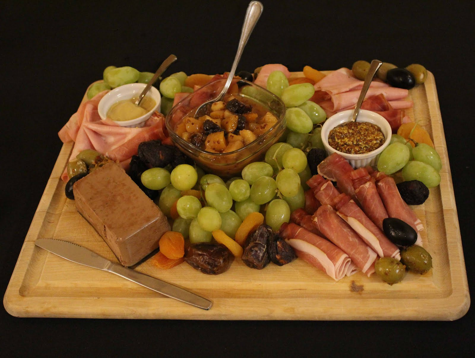 Colonel Mustard's platter of prepared meats, mustards and motarda