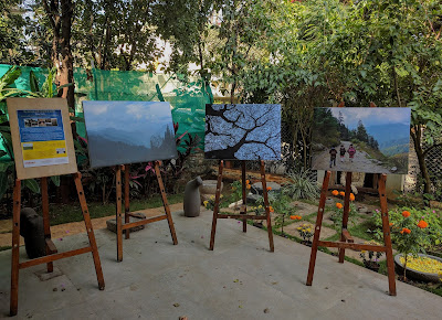 Display of Milind Sathe's pictures on easels at the entrance of Indiaart Gallery