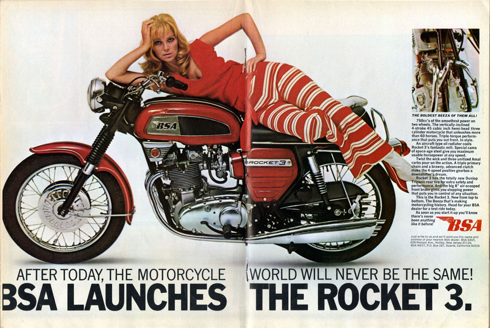 Model posing on motorcycle in advertisement.