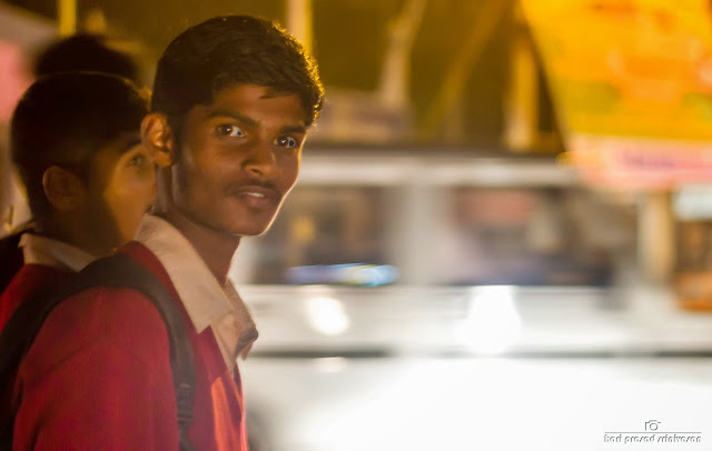 Street photography. Potrait of a school kid. Night photography