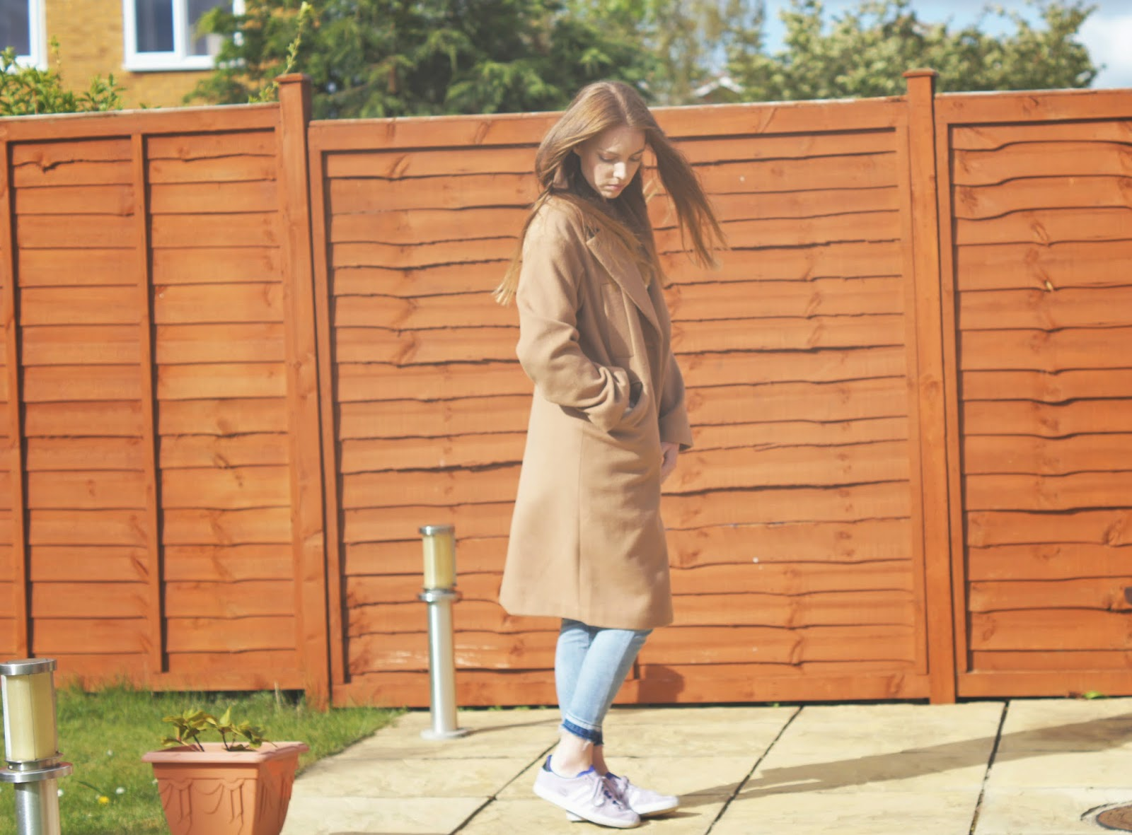 camel coat and lilac adidas trainers