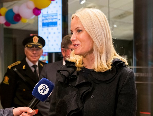 Crown Princess Mette-Marit wore Prada coat and Gianvito Rossi Leopard Print Shoes for Kristiansand International Children's Film Festival
