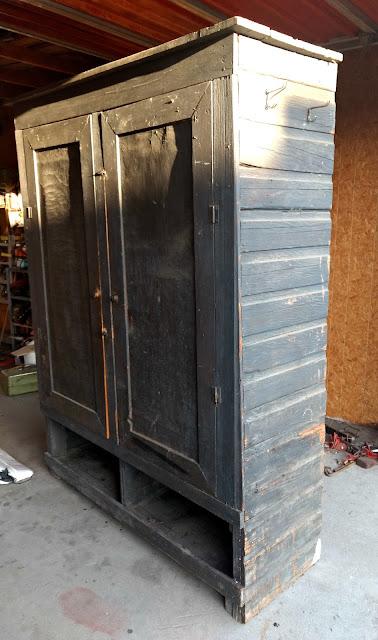 primitive cupboard before