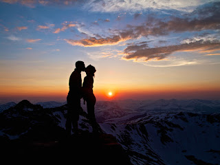 Lovers-kissing-image-with-sunset-behind-mountain-background-image.jpg