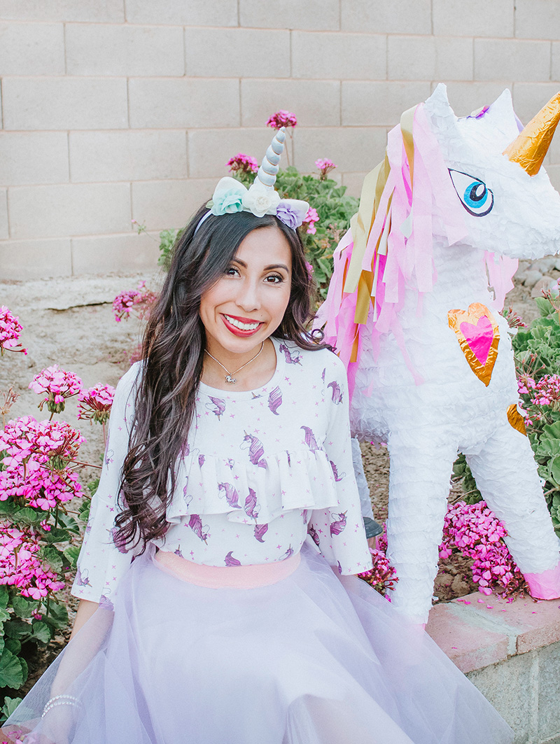 smile with big unicorn pinata