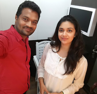 Keerthy Suresh in White Dress with Cute and Awesome Lovely Smile with a Lucky Fan 1