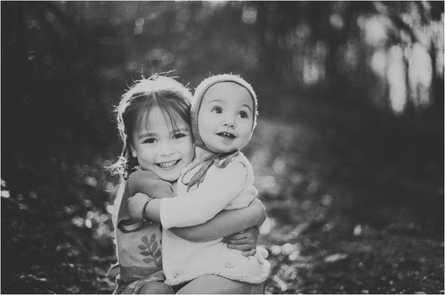 A sibling hug