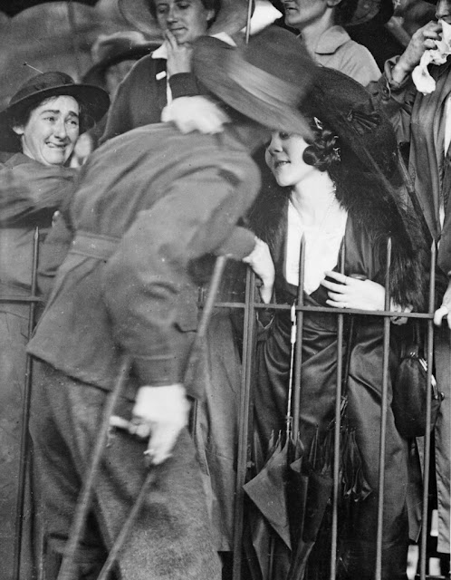Sydney, NSW. 1919. A wounded AIF soldier receives an affectionate welcome home at the Anzac Buffet in The Domain. This photograph is from the Australian War Memorial's collection.
