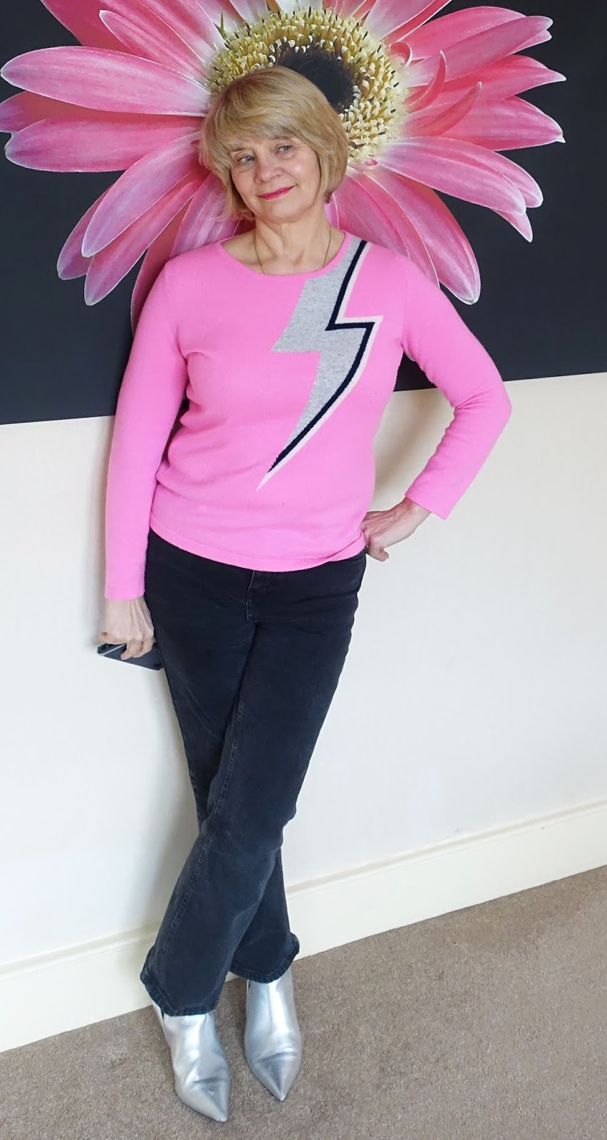 "A pink cashmere jumper with the ""Bowie flash"" by British firm Orwell and Austen, worn with black jeans and silver boots"