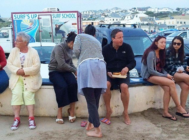 I don't care! David Cameron seen barefooted, eating fish in public