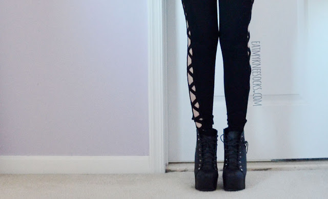 All-black lattice style criss-cross cutout side leggings from SheIn.