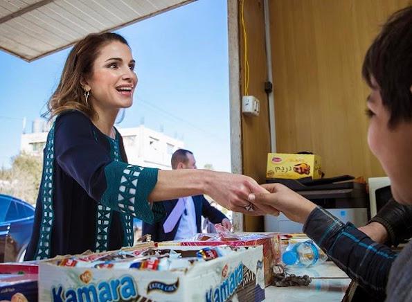 Queen Rania of Jordan visited the Community Center Association (CCA) in Al Zarqa, Jordan. Style of Queen Rania wore Balmain blouse