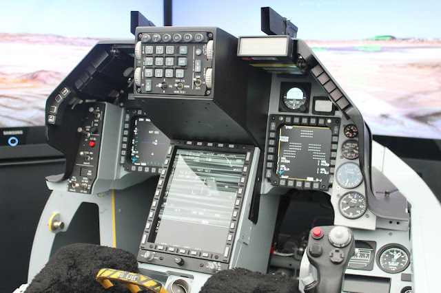 Image Attribute: The mockup of the F-16V cockpit shows the large center pedestal display (CPD) that is being provided by Elbit Systems of America. / Source: Aviation International News / Photo: Chris Pocock
