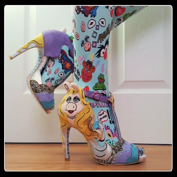 side view wearing Irregular Choice Original Diva Miss Piggy shoes and colourful Muppets tights