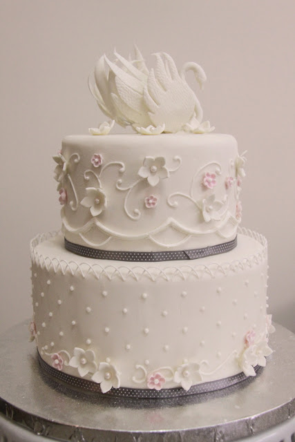 http://www.cakecentral.com/gallery/i/2896670/swan-wedding-cake