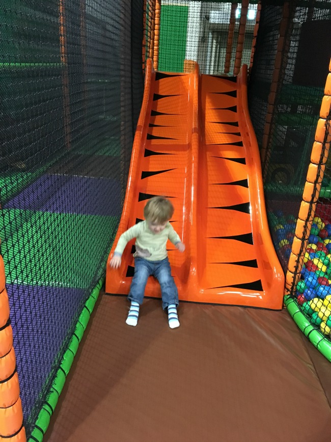 Mambo-Soft-Play-Cardiff-A-Toddler-Explores-image-of-toddler-on-slide