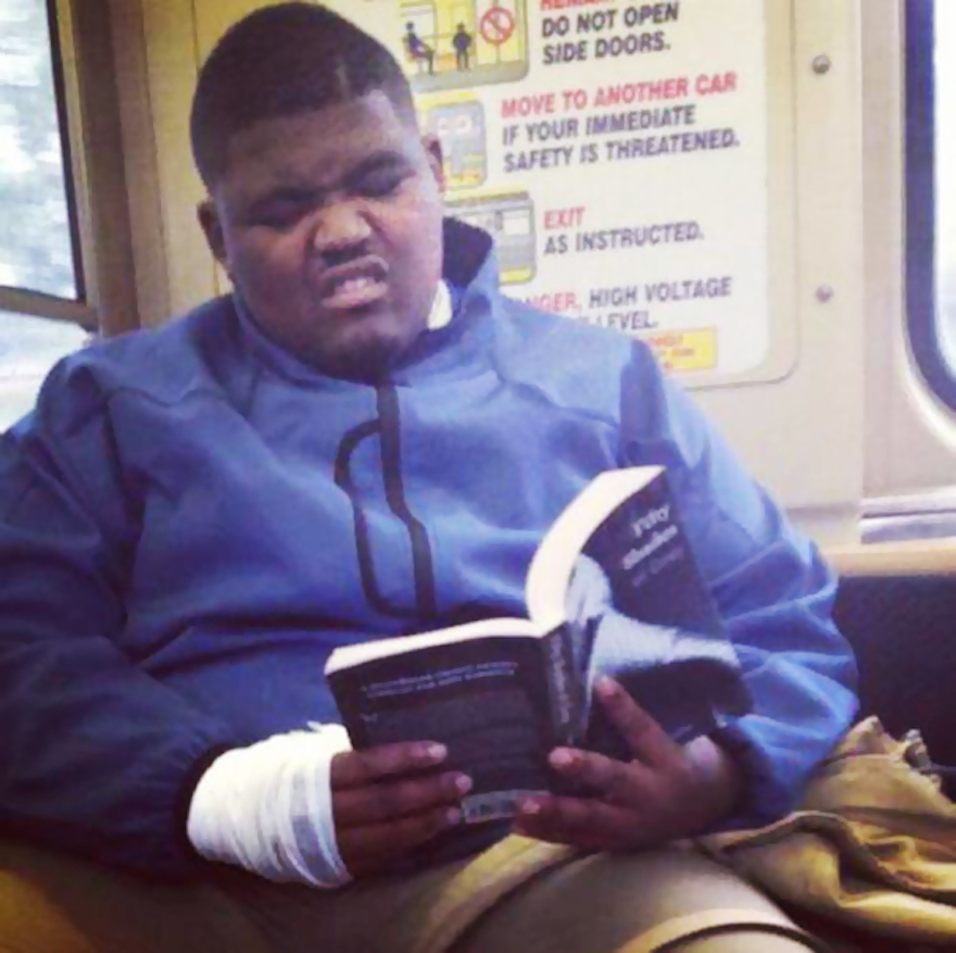 17 Hilarious Pictures Of People Reading All The Wrong Books In Public - Men Reading Fifty Shades Of Grey