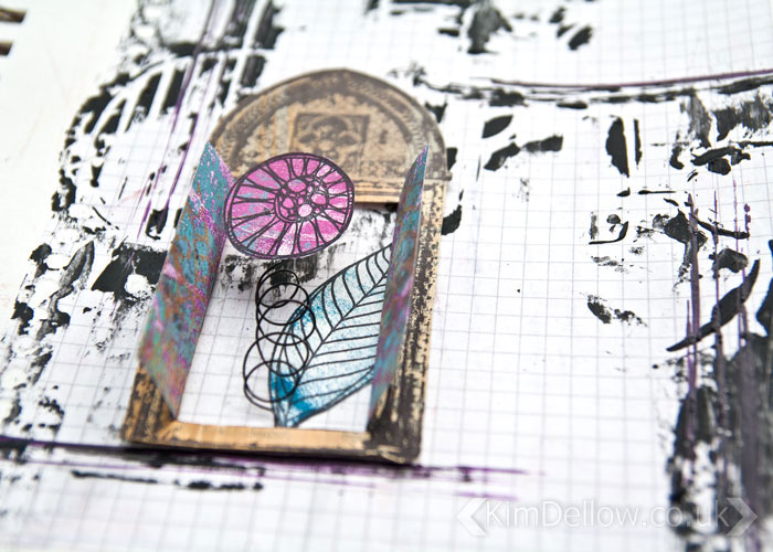 The secret behind the door on the grungy but cute interactive Art journal page by Kim Dellow