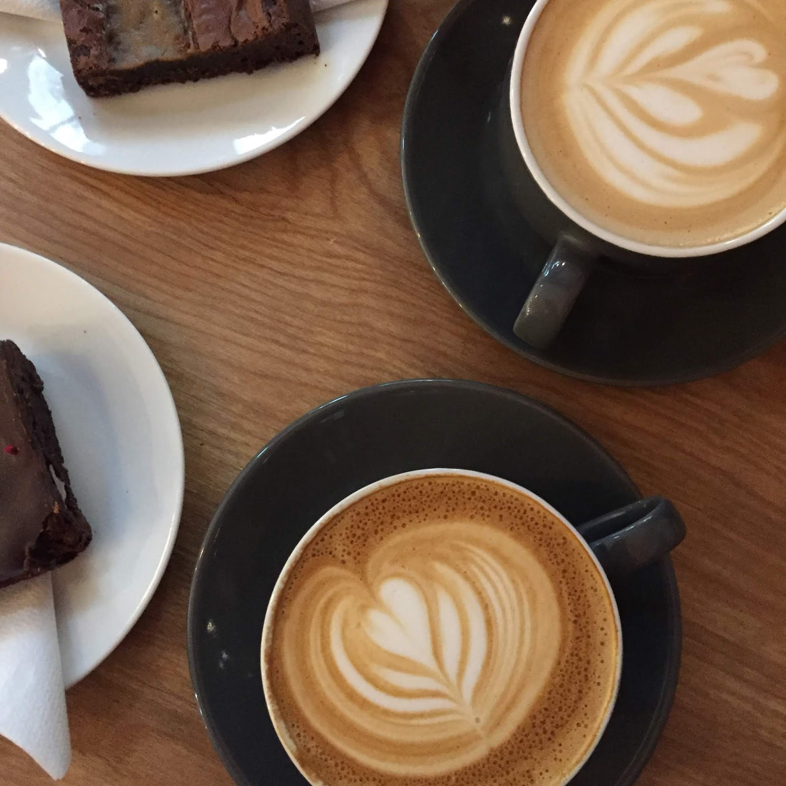 two lattes and brownies on table