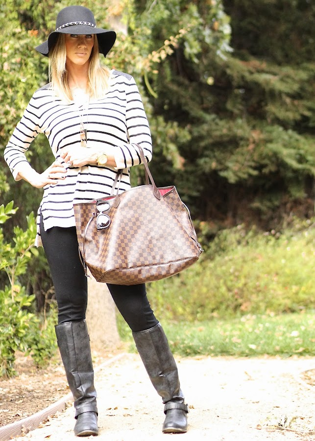 striped sweater with leather details and black leggings layered necklaces